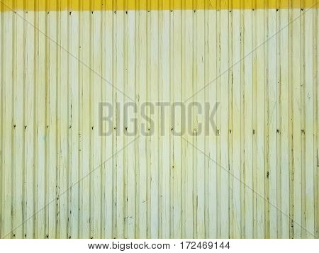 Metal cladding wall design old lemon house color texture background with bolts in the lower part.