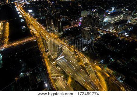 Aerial View Road Traffic Transportation And City In Bangkok At Night, Top View