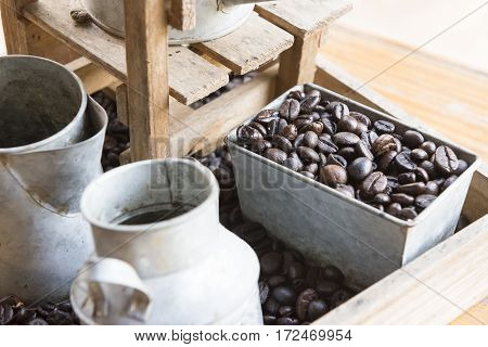 coffee beans in the container box on the wooden table
