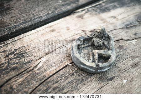 Art ashtray empty women style vintage with wooden background