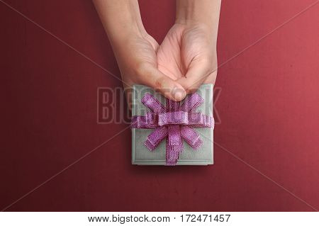 People Hand Holding Small Gift For Mother's Day
