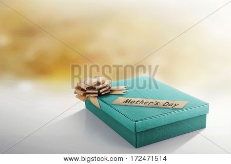 Green Gift Box With Golden Ribbon For Mother's Day