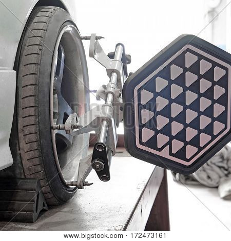 Wheel alignment equipment on a car wheel