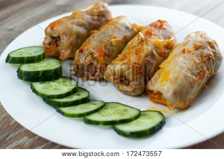 stuffed cabbage is a traditional Ukrainian meals stewed cabbage leaves stuffed with ground meat and rice with sour cream with sliced cucumbers