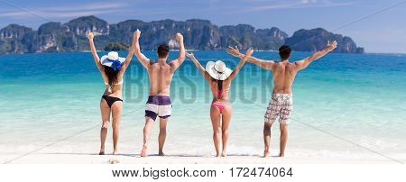 Young People Group On Beach Summer Vacation, Two Couple Raised Hands Friends Walking Seaside Sea Ocean Holiday Travel