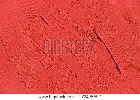 Painting close up of vivid red color, paint brush strokes  texture for interesting, creative, imaginative backgrounds. For web and design.