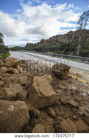 Storm related landslide blocking Santa Susana Pass Road in the San Fernando Valley area of Los Angeles, California.