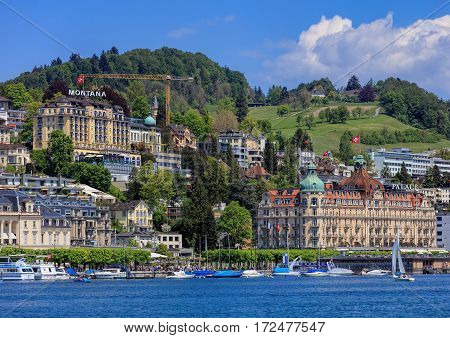 Lucerne, Switzerland - 8 May, 2016: buildings along Lake Lucerne, people on the embankment of the lake. Lucerne is a city in central Switzerland, it is the capital of the Swiss Canton of Lucerne and the capital of the district of the same name.