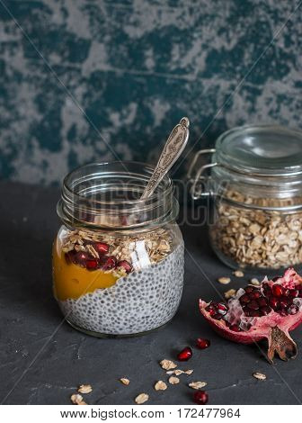 Chia pudding with mango puree granola and pomegranate - a healthy breakfast or snack.