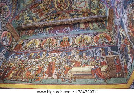 Suceava, Romania - April 30, 2014: Frescoes inside church in monastery Voronet. One of Romania's painted Orthodox monasteries in southern Bucovinaregion Suceava Romania