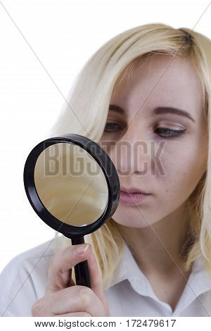 Portrait of beautiful young woman with magnifier glass