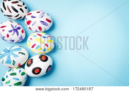 Easter. White painted eggs on a blue background. Easter ideas. Easter eggs. Space for text.
