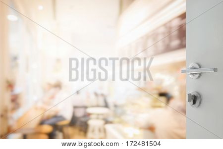 Opened White Door To Coffee Shop Interior As Background