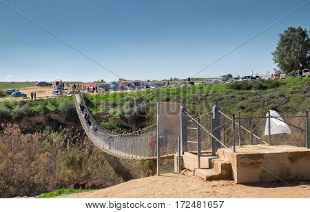 People On Suspension Bridge Over Besor River In Eshkol National Park. Negev Desert. Israel