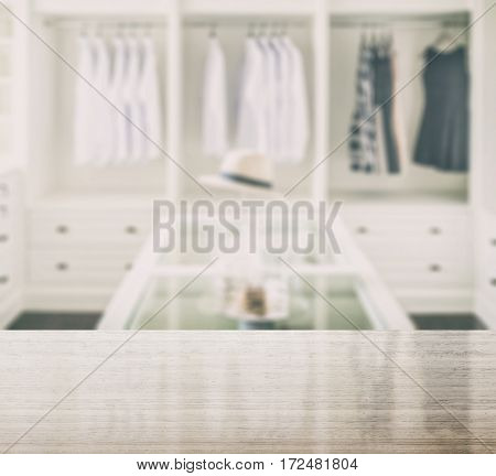 Granite Table Top And Blur Of Closet Room With White Hat And Jewelry Set On A Table