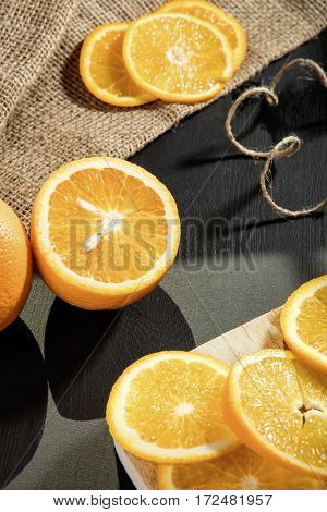Orange and orange slices on worktop