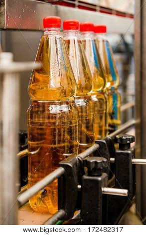 Filling bottles with sweet drink at a factory