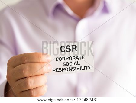 Businessman Holding A Card With Text Csr Corporate Social Responsibility