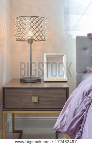 Cozy  And Classic  Bedroom Interior With Pillows And Crystal Reading Lamp On Bedside Table