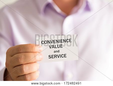 Businessman Holding A Card With Text Convenience, Value And Service