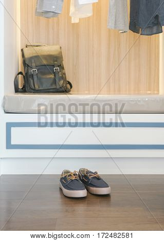 Men's Sneaker And Leather Bag At Modern Style Walk In Closet
