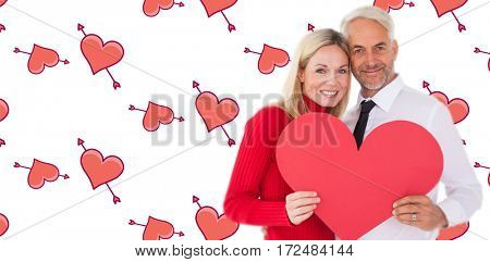 Handsome man getting a heart card form wife against
