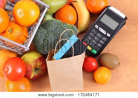 Payment Terminal, Contactless Credit Card, Paper Shopping Bag And Fruits With Vegetables