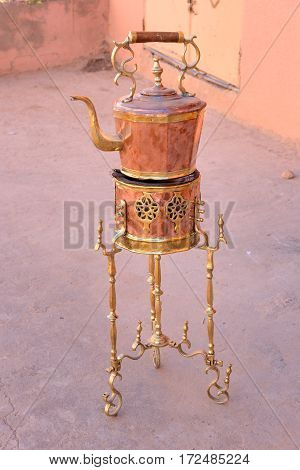 Traditional Copper kettle and burner on sale in the street. Morocco