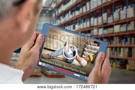 Fast forward sign on digitally generated blank screen against man using digital tablet