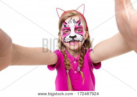 cute little girl with painted animal mask on face making selfie isolated on white background