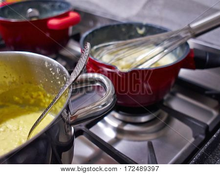 Chef cooks in restaurant kitchen by the gas stove great cuisine background image