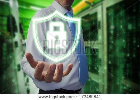 Businessman holding hand out against image of data center