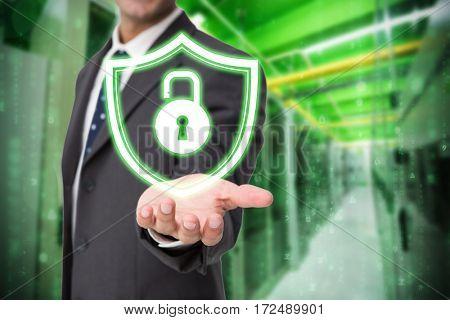 Businessman presenting against image of data storage