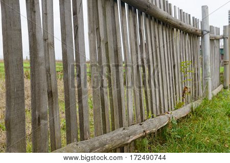 broken old wooden fence in the yard
