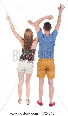 Back view of  joyful couple celebrating victory hands up. Rear view people collection. backside view of person. Isolated over white background.
