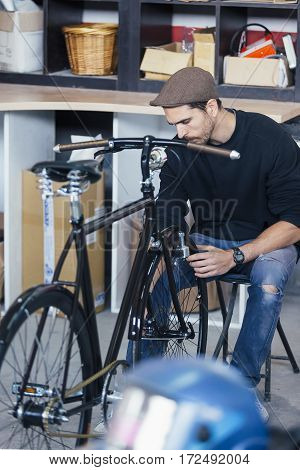 Craftsman assembling origin handmade bicycle at workshop