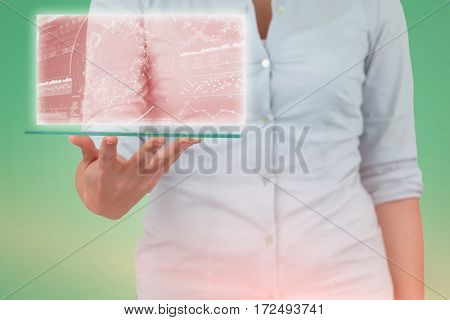 Midsection of businesswoman pretending to hold digital tablet against genes diagram