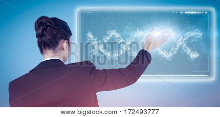 Rear view of businesswoman using digital screen against blue background