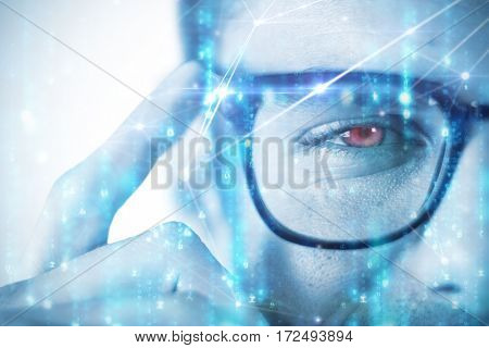 Man wearing spectacles against glowing blue background
