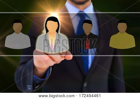 Businessman pointing his finger at camera against black background with vignette