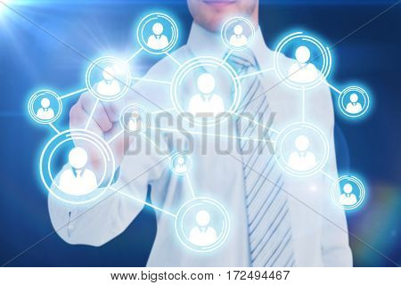 Businessman in shirt pointing with his finger against blue background with vignette