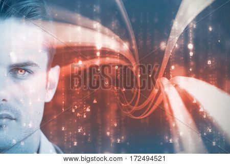 Portrait of man with blue eyes against computer screen with wallpaper