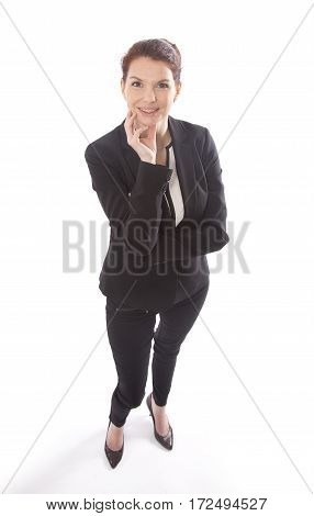 Young businesswoman standing and looking up isolated on white background