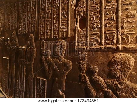 Hieroglyphic drawings and paintings on the wall of the corridor of the ancient Egyptian temple