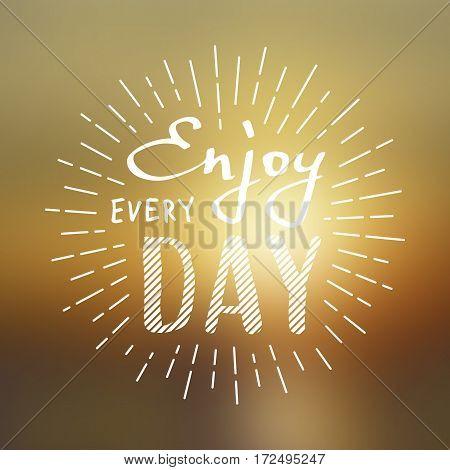 Slogan Enjoy every day. Vector illustration on blurred background. Lettering