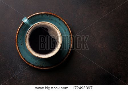 Coffee cup on old kitchen table. Top view with copyspace for your text