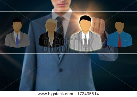 Midsection of businessman pointing against black background with vignette