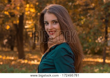 girl with red lips stands in the street and smiling