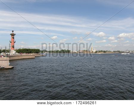 View at the Admiralty across Neva River and Rostral Columns at the Spit of Vasilievsky Island in Saint Petersburg, Russia