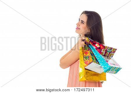 young girl turned sideways and keeps the shoulder beautiful bags isolated on white